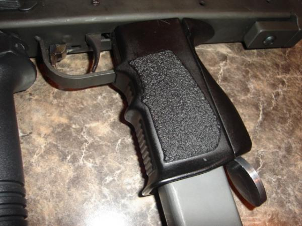 Molded wrap around grip for M-11 9mm